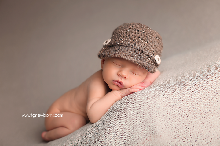 newborn with hat