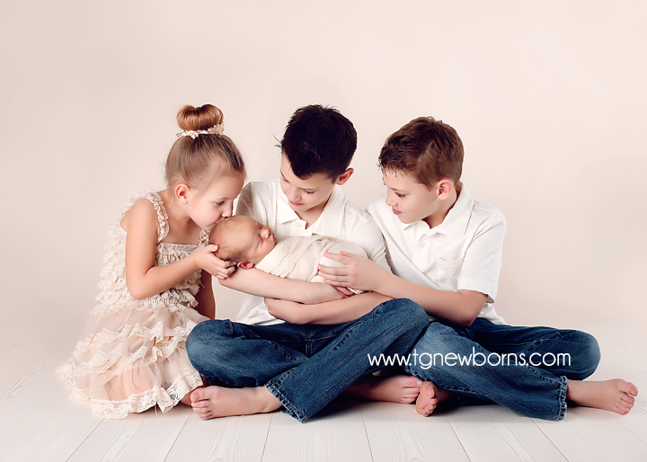 newborn baby sibling pose