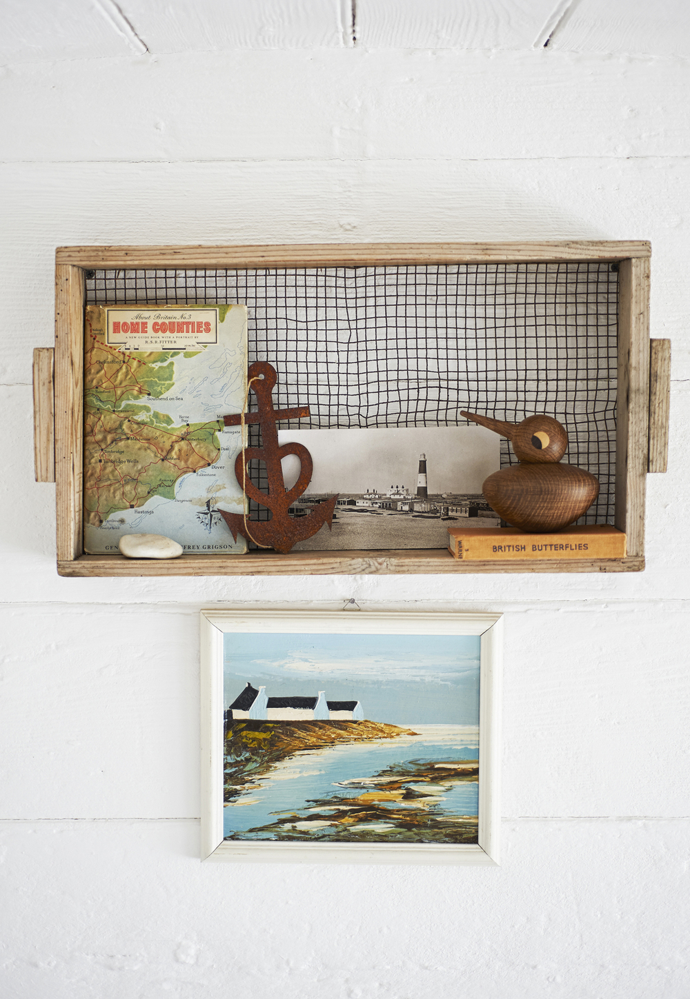 Bedroom detail: An old garden sifter serves as a pretty nest for Kristian Vedel's wooden bird and Dungeness keepsakes