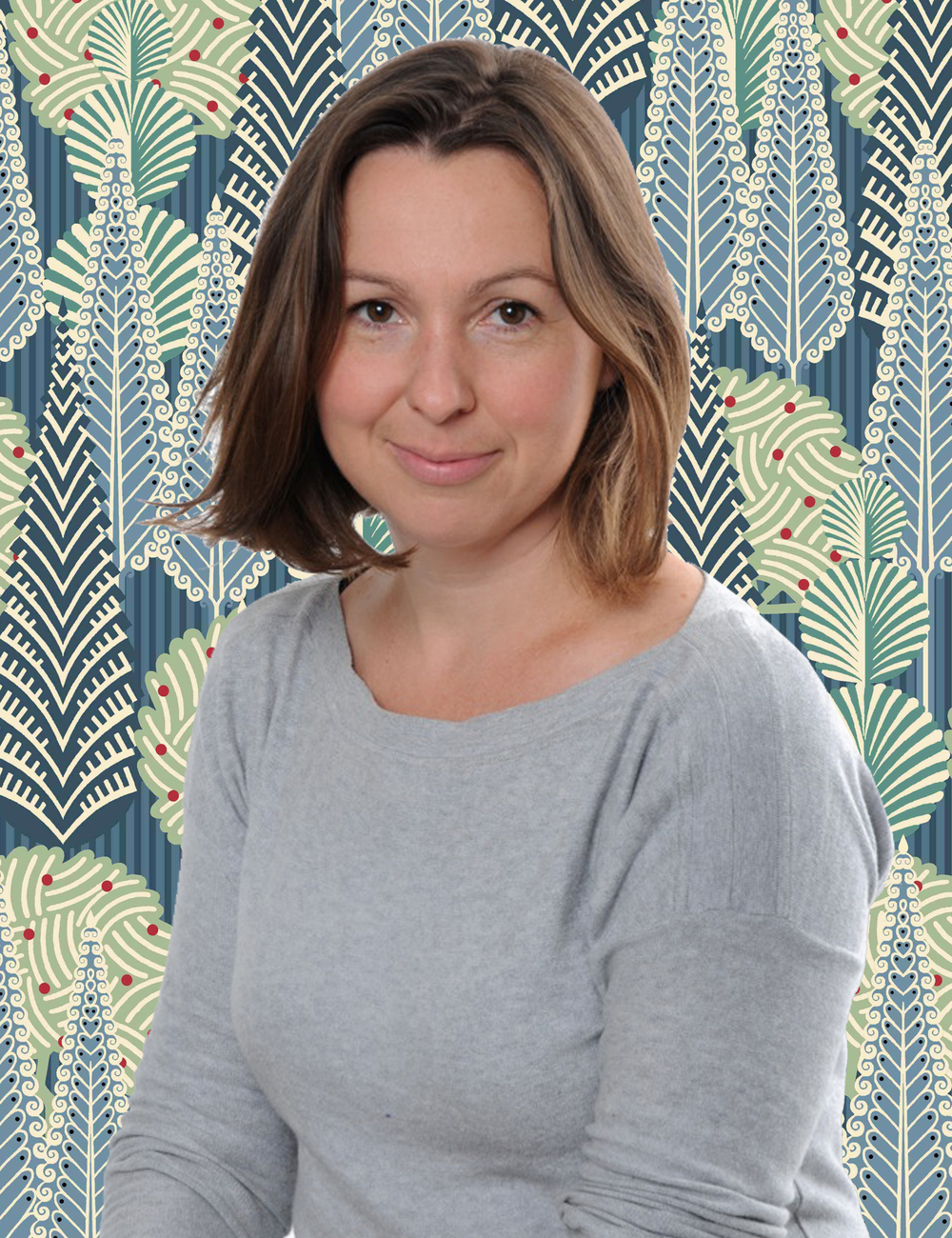 Pia Benham, Head of Fabric and Design at Heal's. The luscious background is the 'Trees' print by Cressida Bell