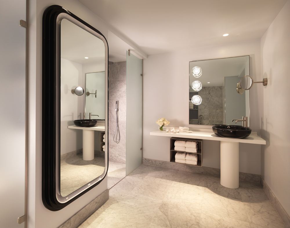 Movie star glamour reigns in the sleek marble bathrooms