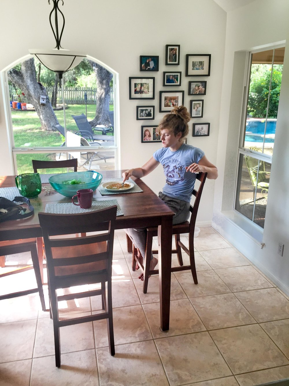 My girl, sitting at my breakfast table for the very last time before hitting the road. I deeply wished for a pause button.