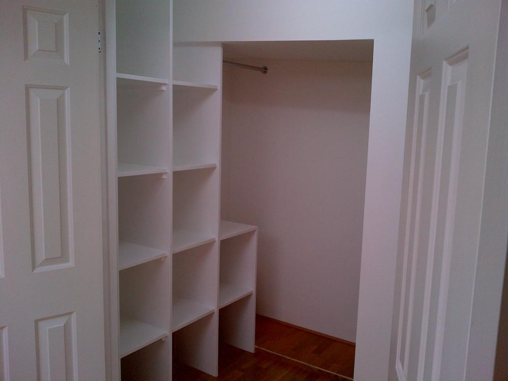 36 Lauderdale - Walkin wardrobe finished with bespoke storage facilites.jpg