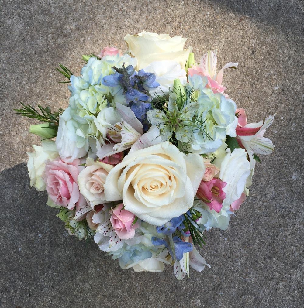 Hydrangea, roses, delphinium and alstromeria
