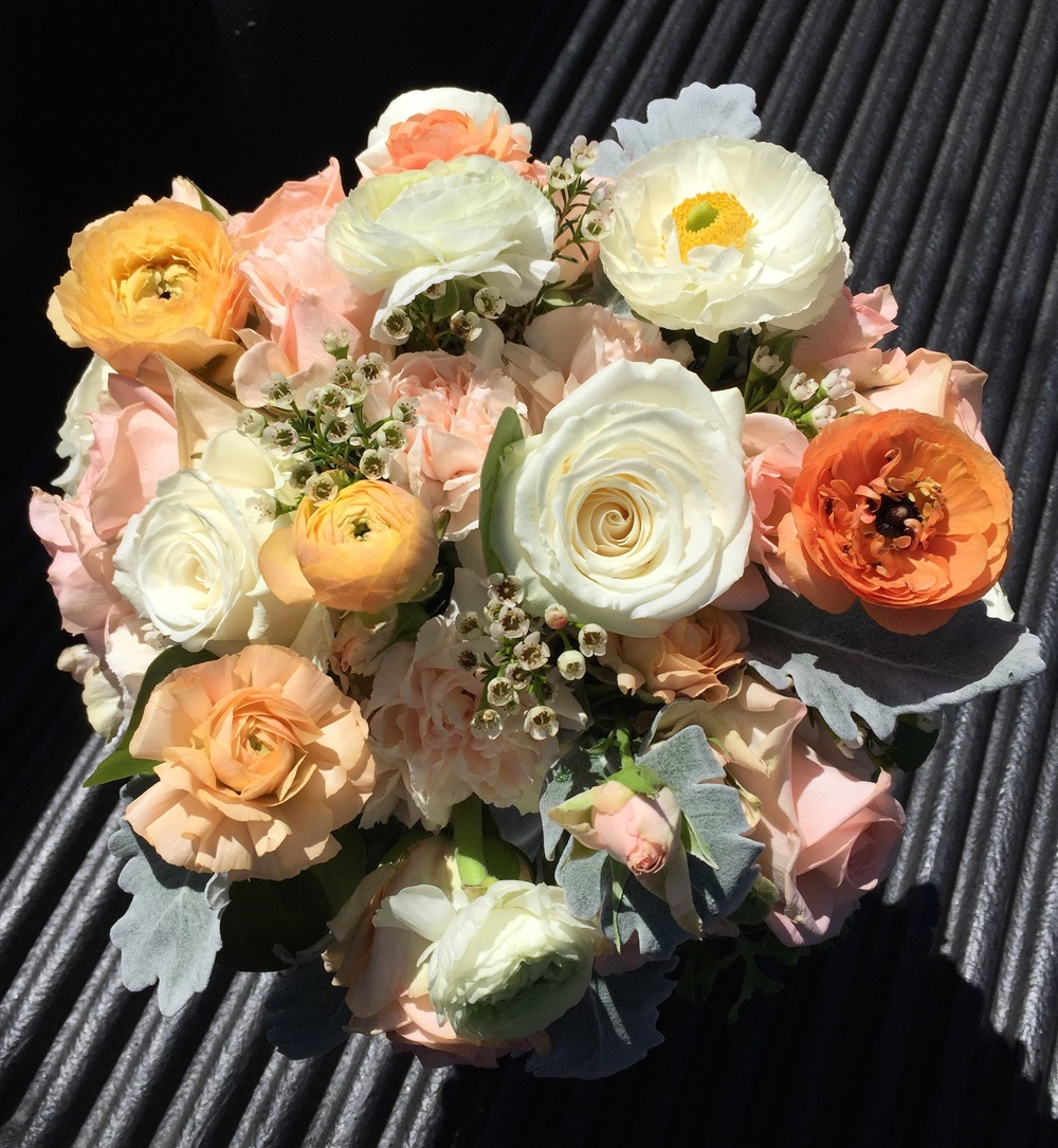 Roses, Ranunculus, Waxflower and Dusty Miller