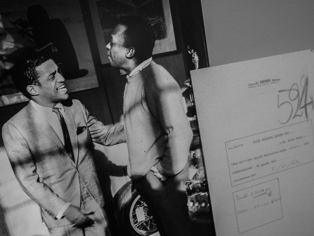 Sammy Davis Jr and Miles Davis were both Ferrari owners, pictured here at a Ferrari dealership with an order form for one of their cars