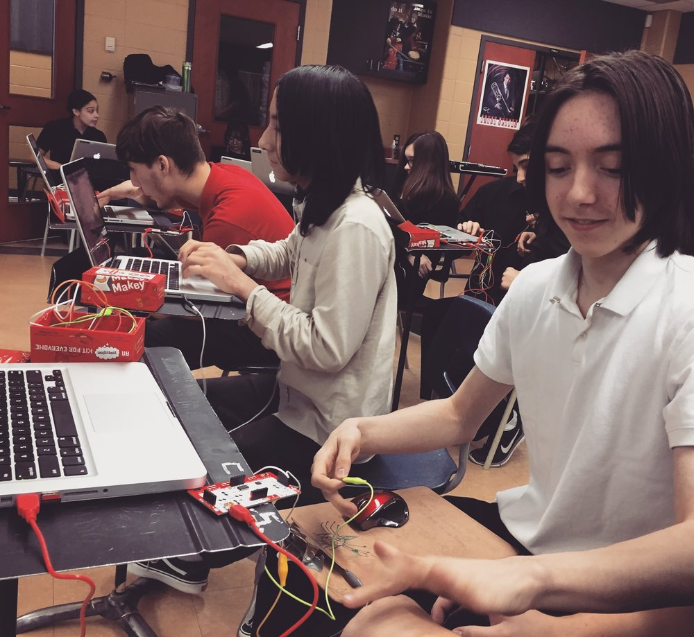 Sonic Signature  - This workshop teaches students how make interactive music by recording sounds from their environments and then controlling those sounds using microcontrollers like the Makey Makey with their computers. The aim of this workshop is to empower students from the ages of 10-13 to become inspired by the sounds of their environment while developing a basic understanding of coding, electronics, and audio recording.