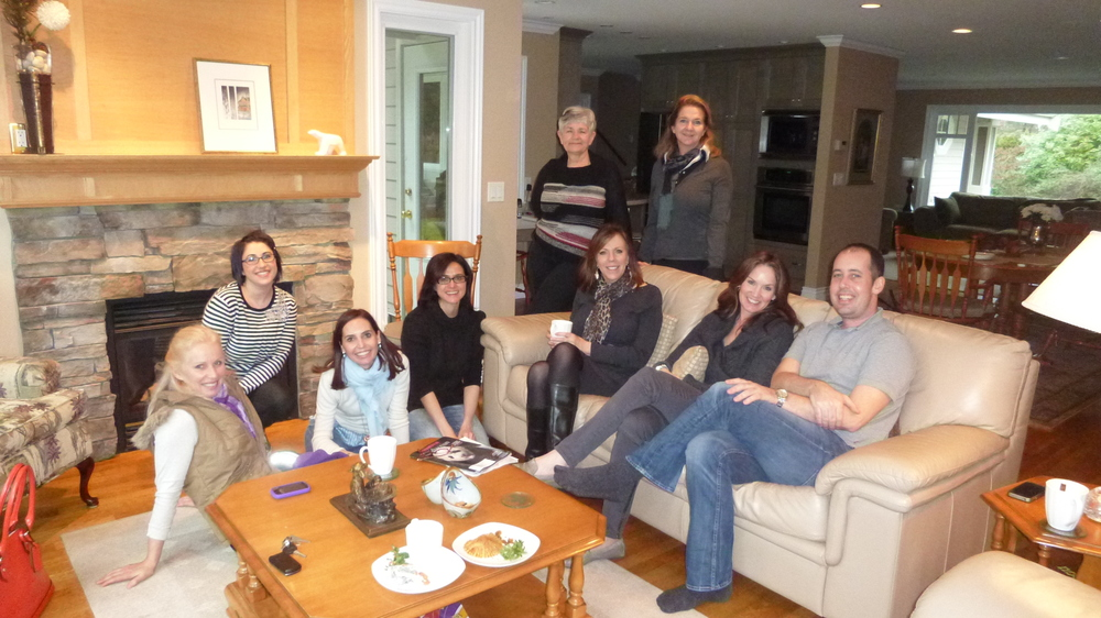 From left to right: Morag Currin, Kerry Kourie, Angela Noviello, Luisa Gullace, standing: Vivian Walwyn, Annemarie Puppe, seated on couch: Becky Kuehn, Jeanna Doyle and Drew Flanagan