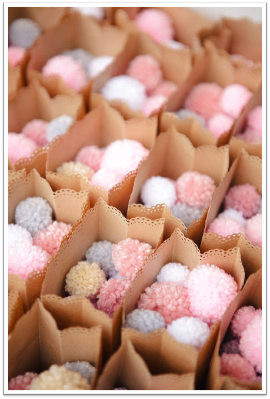 {Via} These pompoms look like flower petals - so cute! Pick colors that coordinate with your wedding theme.
