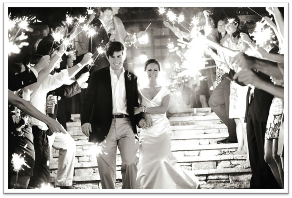 {Via} Sparklers make for a dramatic but gorgeous send-off.