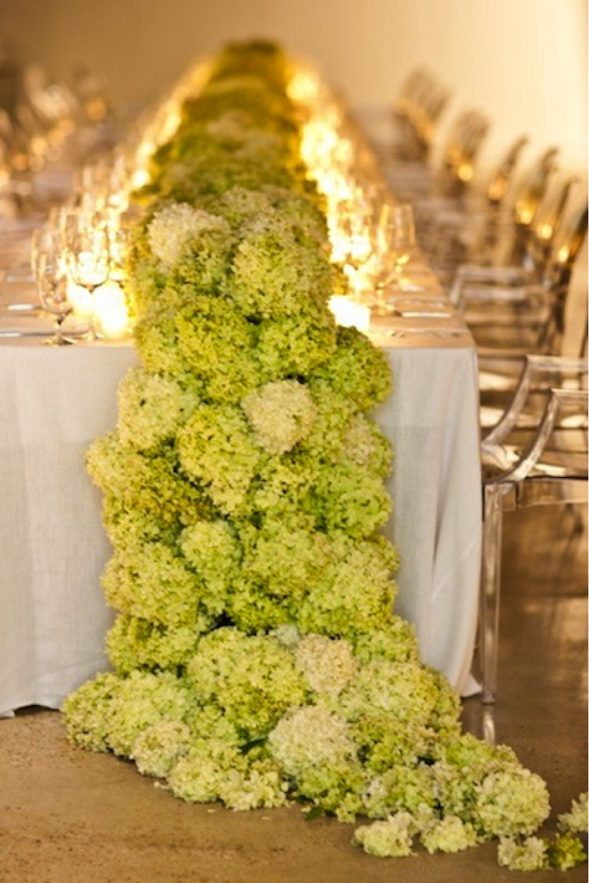 This gorgeous hydrangea table runner is the only decoration needed in this setting  { Via }