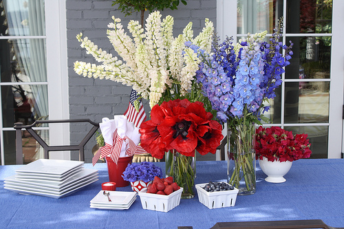 {Via}  A more elegant look for your Fourth of July festivities are floral arrangements. These are not only patriotic in the color scheme but also in the sense that they resemble fireworks themselves!
