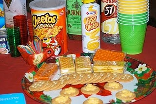 If you want to go all out, add some tacky food to feed your guests! That Easy-Cheese and Ritz Cracker combo looks delicious!