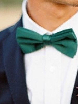 Have your significant other or your groomsmen complement the emerald theme by adding a hint of the color to their wardrobe