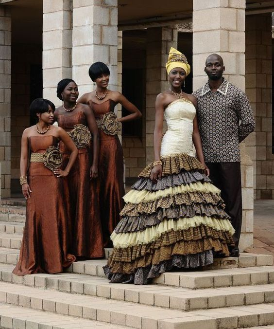 These African brides still embrace their culture and heritage with the dark browns, reds, and golds, however, these stunning brides are adding a modern touch to their traditional gown. Many African brides in a middle to upper class society will be seen wearing wedding dresses of this sort.
