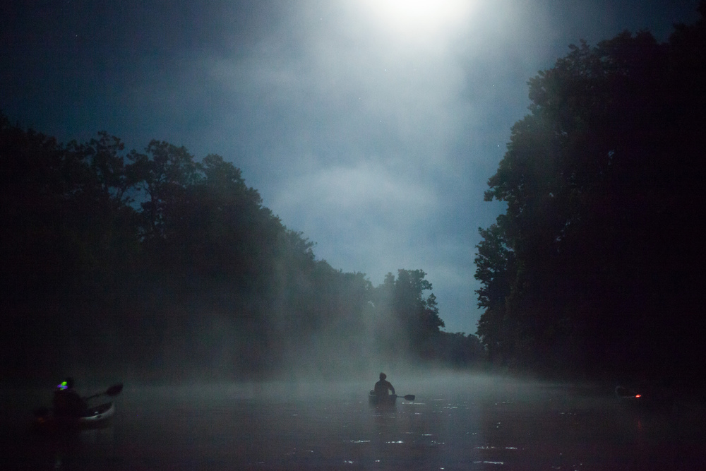 Mist rises off the James River during a midnight float trip in the Ozarks under a full moon.