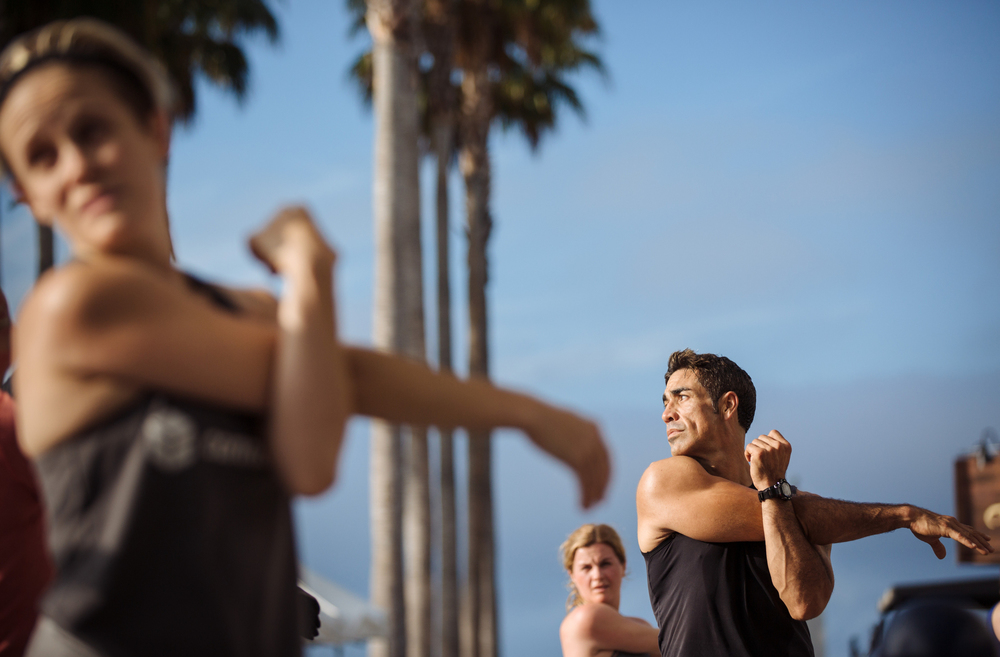 Stretching during a Boot Camp workout at Jack London Square in Oakland, Calif.