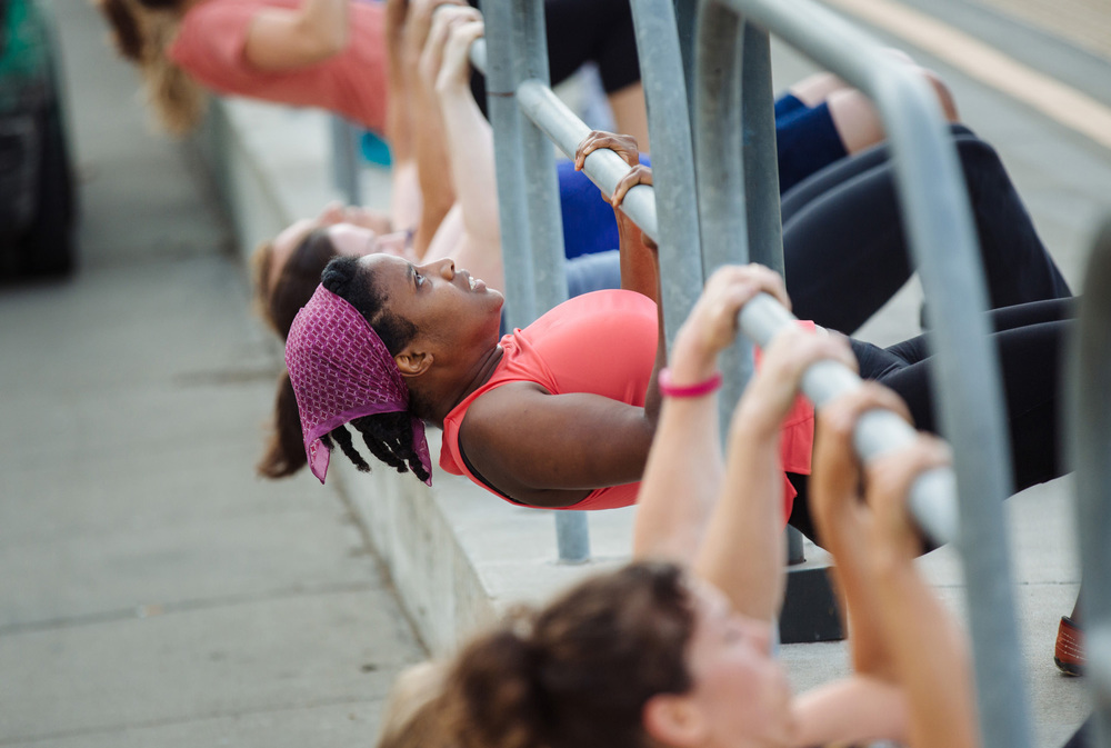 Doing pull ups during Boot Camp workout at Jack London Square in Oakland, Calif.