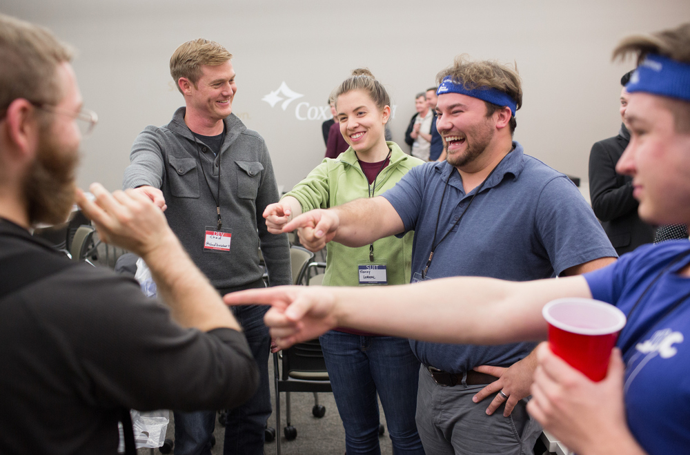Brett Leeper, Chad Boschert, Fanny Loreal, Logan Elsey and Damian Palmer, left to right, take part in an icebreaking exercise at the start of the Startup Weekend Springfield competition at the eFactory in Springfield, Mo. on Nov. 20, 2015. Photos by Brad Zweerink