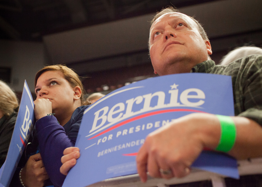 Supporters of Democratic presidential candidate Sen. Bernie Sanders, I-Vt., wait for the candidate to speak during a campaign rally at JQH Arena at Missouri State University in Springfield, Mo., Saturday, March 12, 2016.