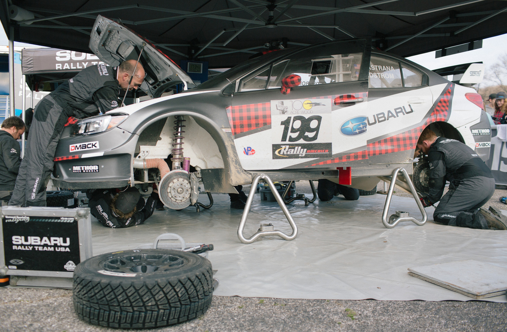 Subaru Rally Team USA crew members work on Travis Pastrana's 2016 Subaru WRX STI.