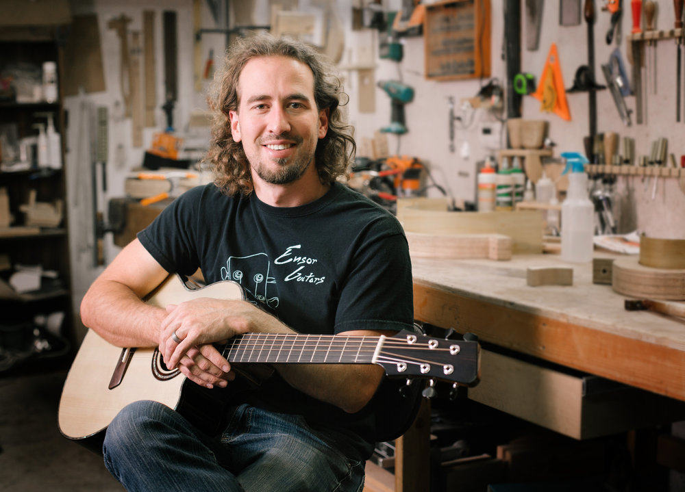 Chris Ensor, holding one of his Ensor Standard guitars made from Brazilian rosewood, Adirondack spruce, ebony and mahogany.