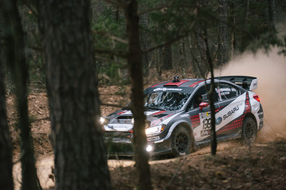 Subaru Rally Team USA driver Travis Pastrana and co-driver Christian Edstrom race down a dirt road on stage six.