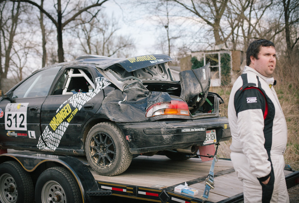 Corey Holmes and his wrecked 1998 Subaru Impreza.