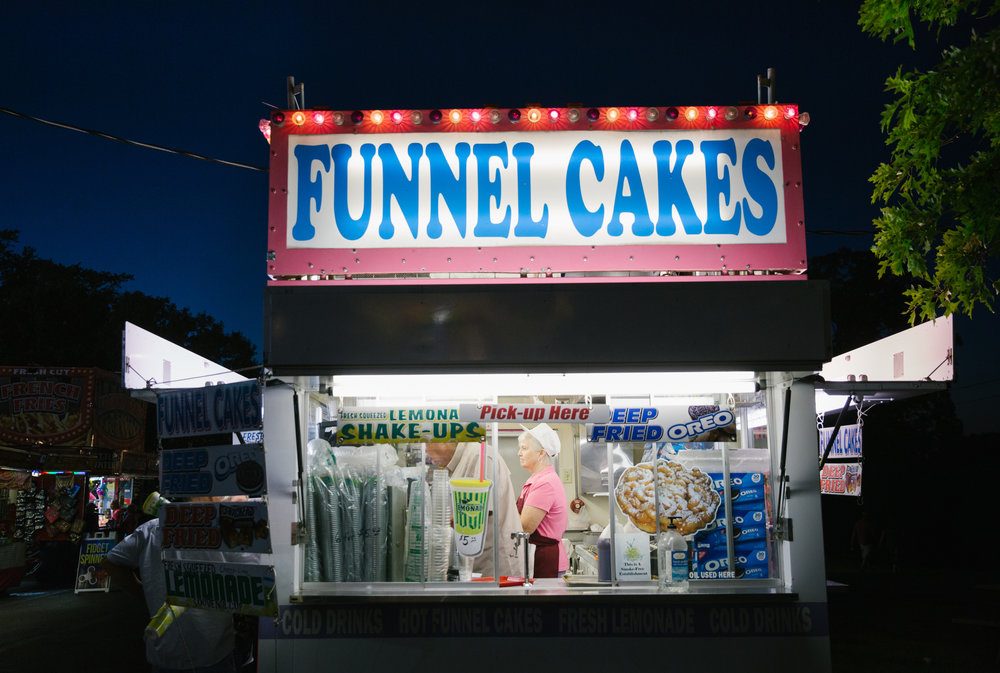 Katha Jackson works a funnel cake stand at the Ozark Empire Fair in Springfield, Mo. on July 28, 2017. Photo by Brad Zweerink.