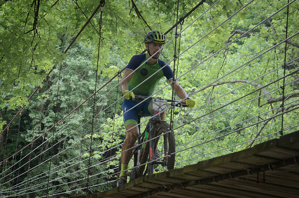 2017 MTB Nats M45-49 winner Brian Schworm crosses the hanging bridge Photo Credit: Butch Phillips