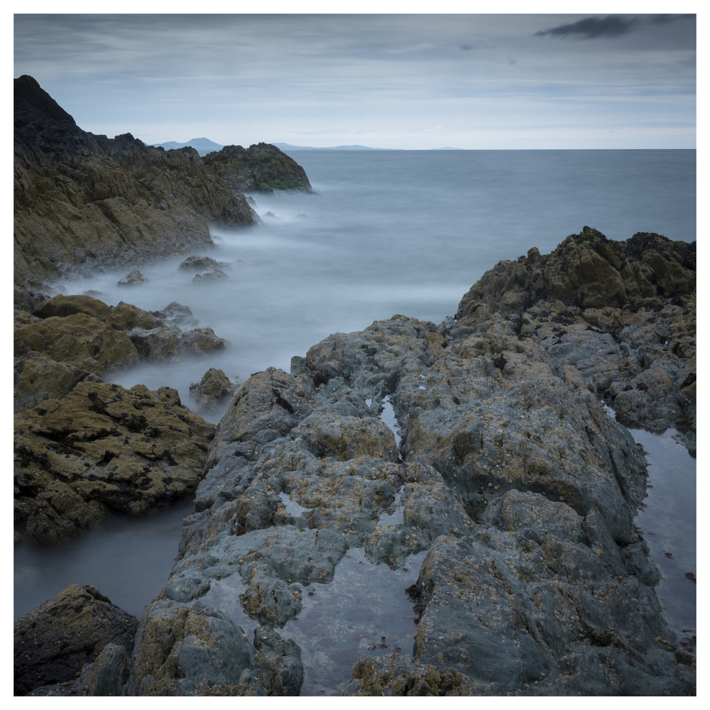Taken looking out South West towards the Llyn Peninsula. Taken using a long exposure with the Lee big stopper to get the misty water effect.