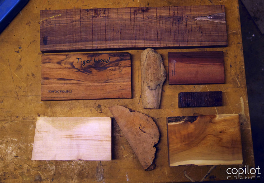 Some samples of the woods I have on-hand including Kingwood (top), Curupau aka Patagonian Rosewood (upper right) Arbutus (bottom left), Maple Burl (bottom center), and Yew (bottom right).