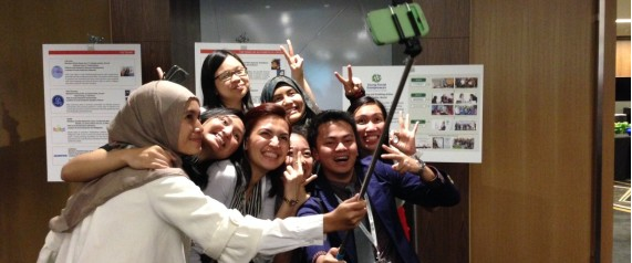 """'It's called a selfie stick,' explains Diana Hemas Sari, a 21-year-old entrepreneur from Indonesia. She's holding an extendable metal wand that has a blue plastic handle at one end and her white Samsung smartphone clipped to the other... ...Gone are the days of blurry, solo self-portraits caught by flip phones in bathroom mirrors. Selfies have become such a social network staple that teens and 20-somethings around southeast Asia, a region that boasts the world's most active selfie-snappers, have invested in these metal wands to perfect their self-portraits, squeeze more people into the frame and be sure they never miss out on a Facebook-worthy moment."" Read the full article here. The Daily Mail goes into further depth on the product here."