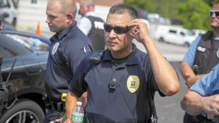 A police officer wears a body camera at a rally for Michael Brown in Ferguson, Mo. Brown, an unarmed black man, was shot and killed by Ferguson police in August. The department began equipping officers with body cameras after the shooting. (Aaron P. Bernstein / Getty Images)