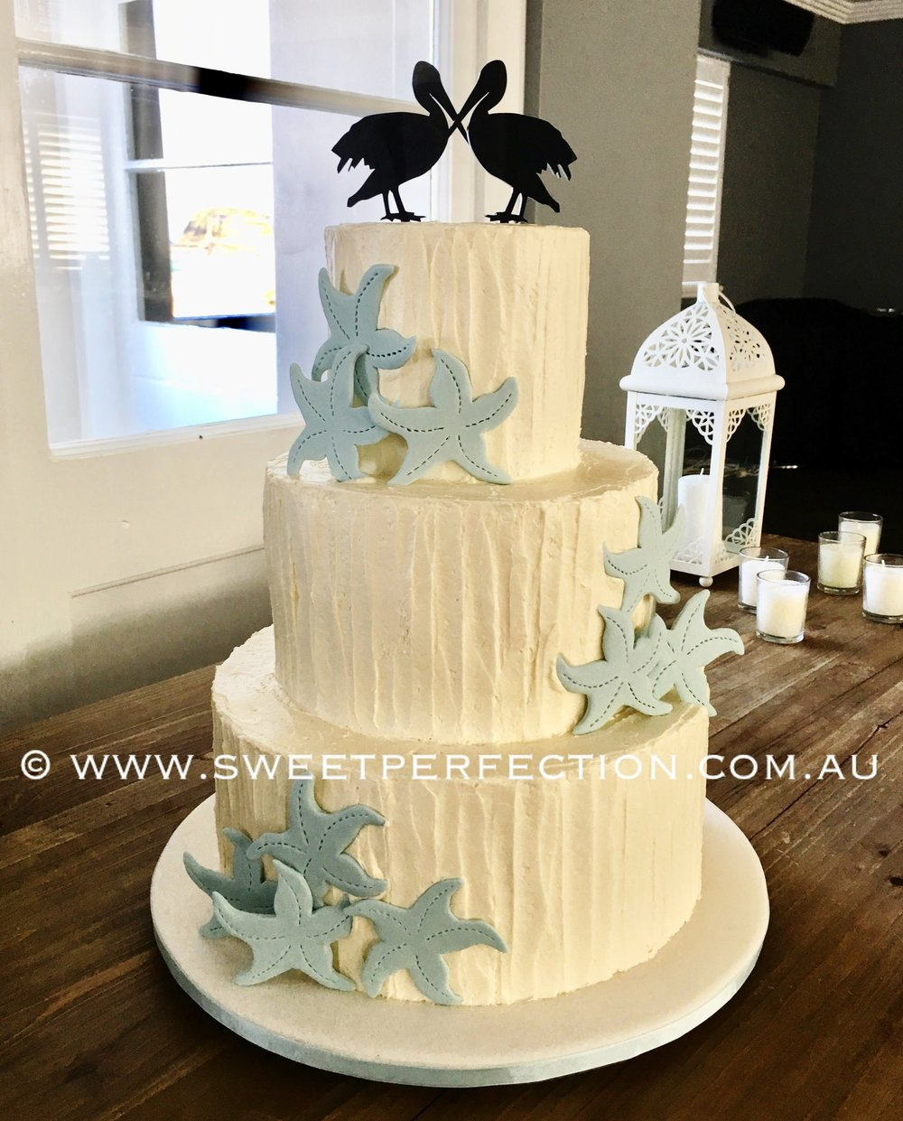Buttercream blue starfish and pelican.jpg