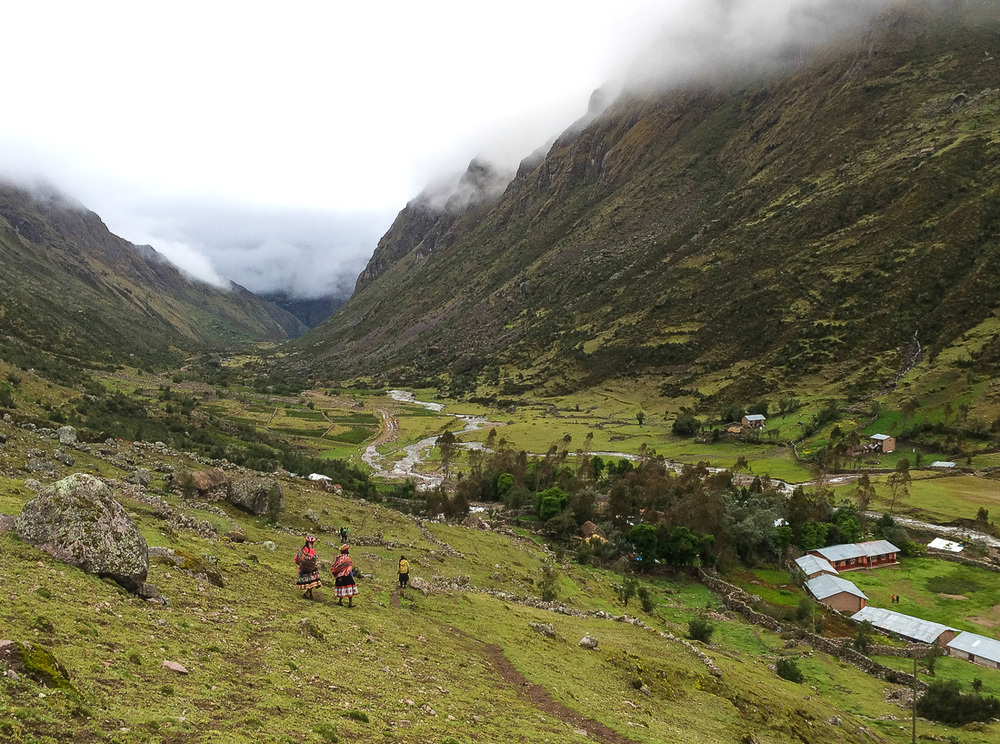Quechua women on their way home in Lares, Peru