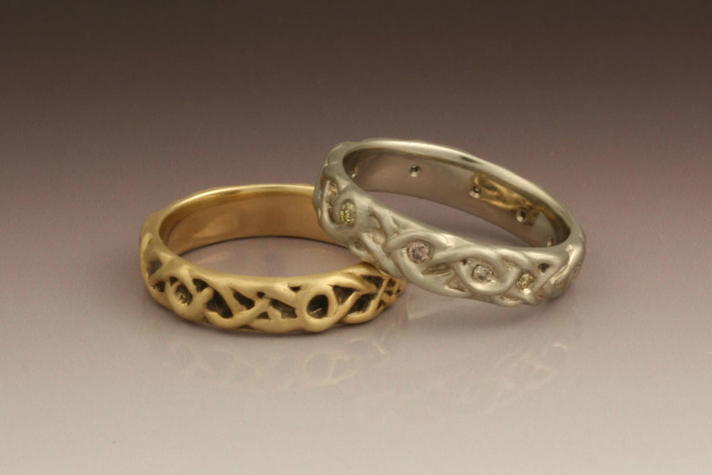 Vine rings in 18 karat yellow gold (oxidized) and 14 karat white gold with pink, yellow and champagne diamonds