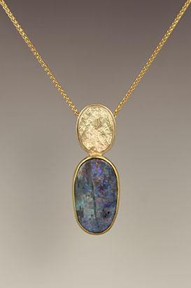 14 karat yellow gold, 22 karat gold bezel with a Boulder opal pendant