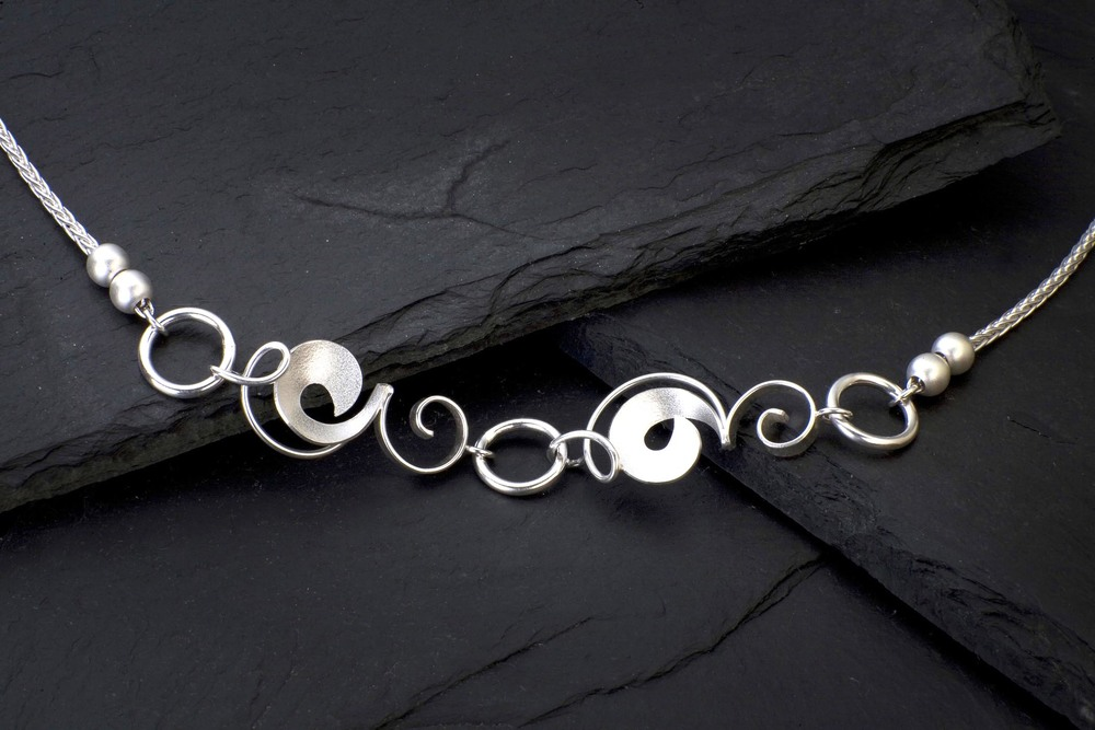 "Sterling silver necklace ""Pea Vines and Circles"" with two fresh water pearls on each side."