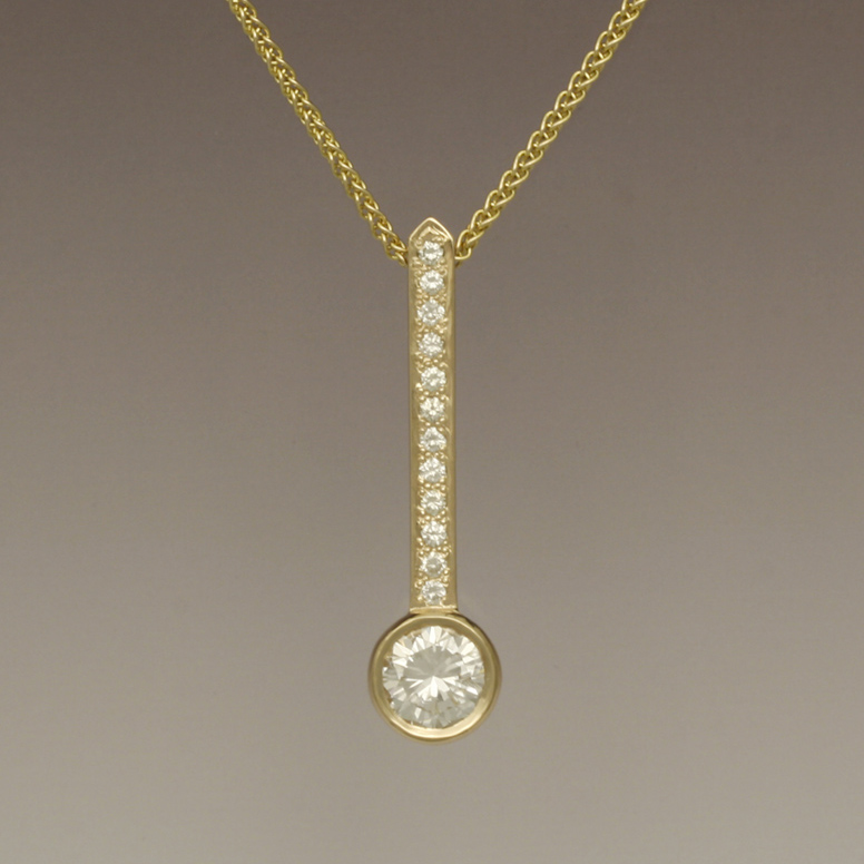 Paul Gross designed gold and diamond pendant.