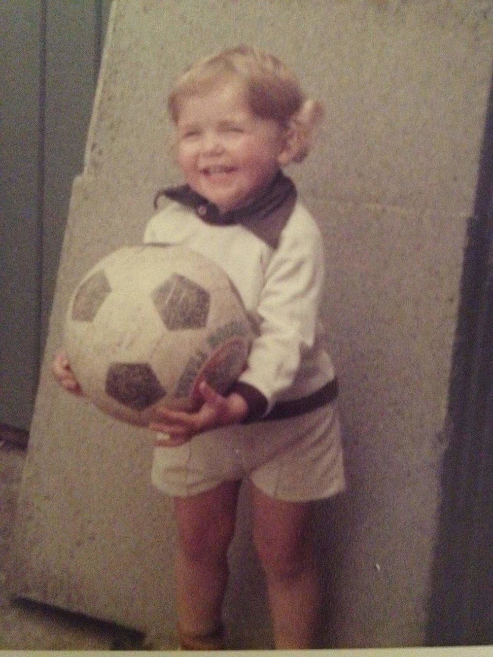 My best mate for a very long time - a football. I am 4 years old here :)