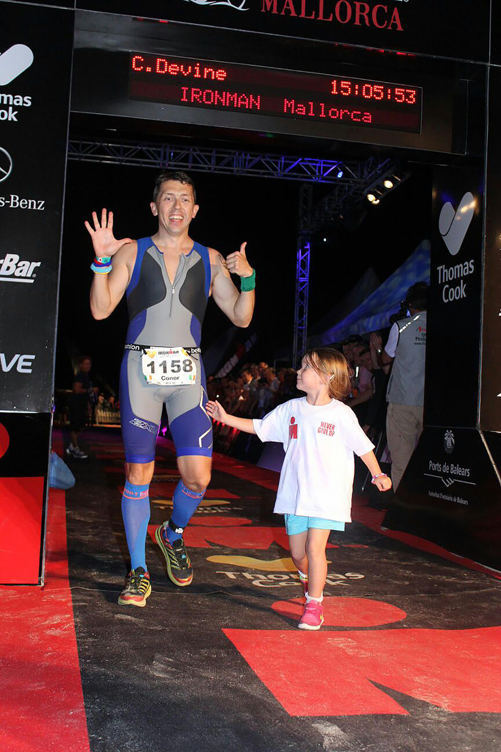Crossing the finish line in Majorca with Lilyanna