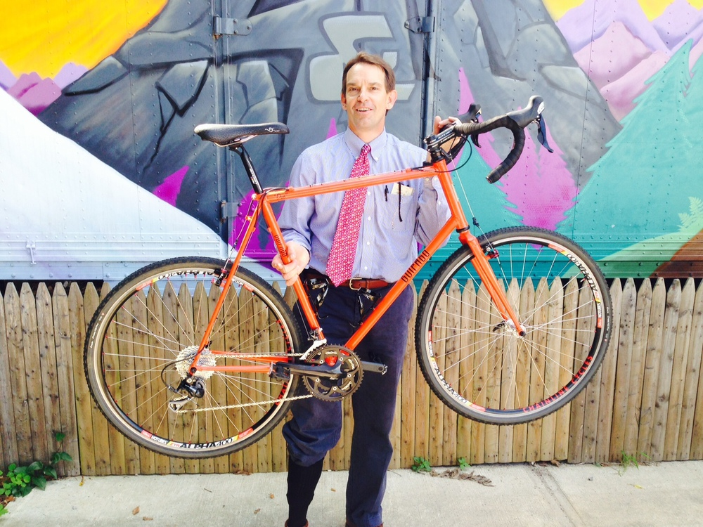 Dr. Sam picking up his new dirt road bike