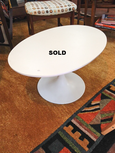Small oval coffee table.