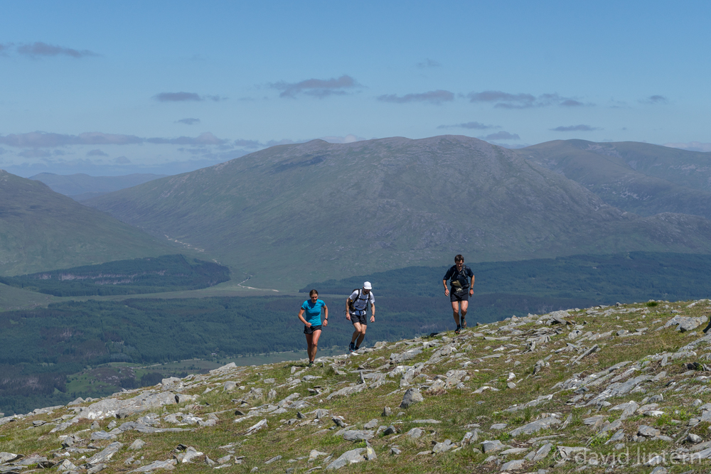 Jasmin Paris plus pacers Finlay Wild and Jon Gay on ascent of Stob Coire Mheadhion
