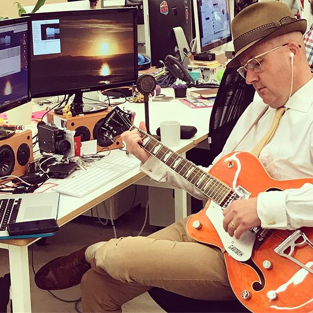 Office strumming #raythehat #sharedoffice