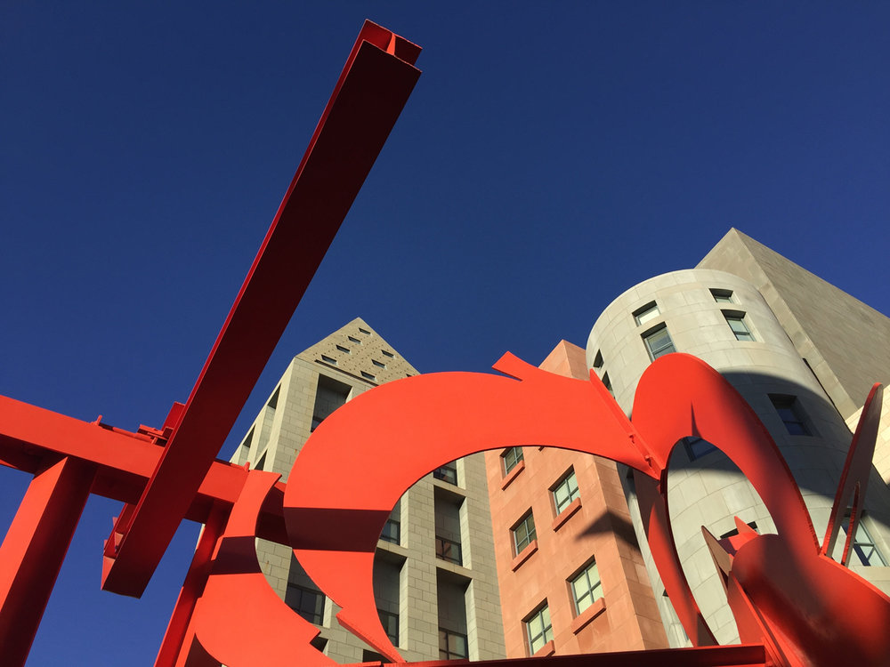 Golden Triangle Creative District: Mark di Suvero sculpture, Lao-Tzu frames the Denver Public Library