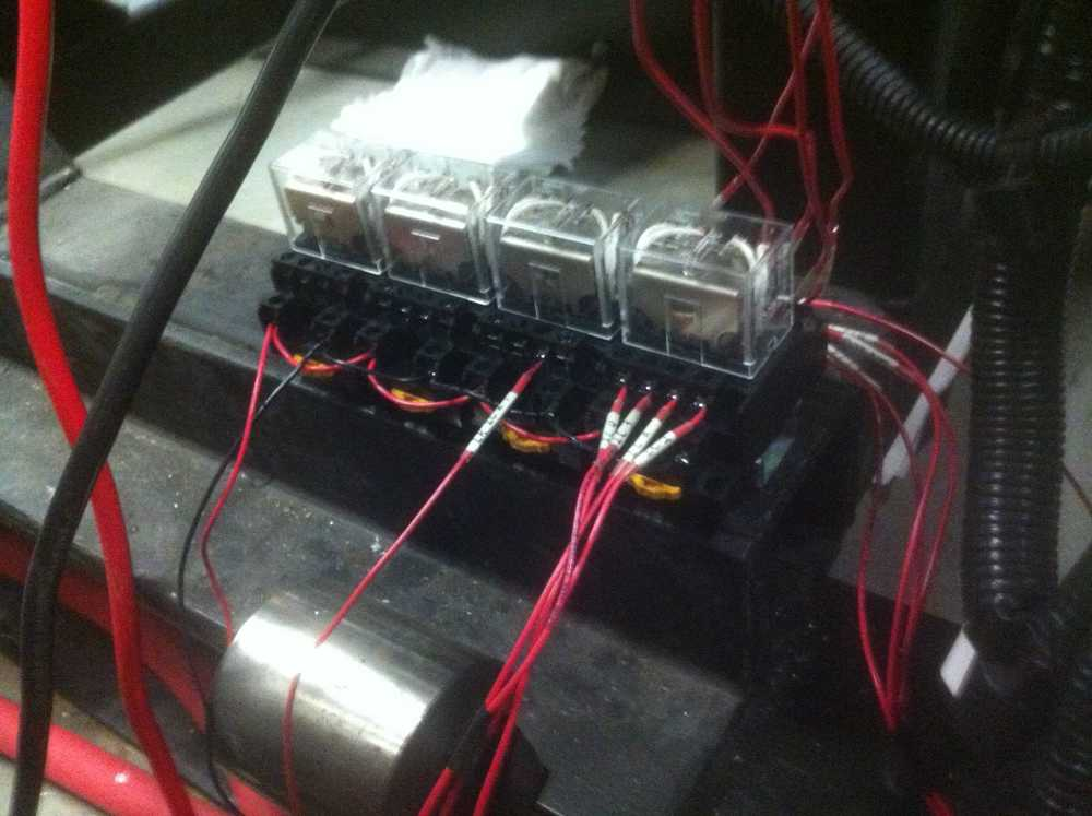 Wires go from the engine into the relay to be switched between RapidPro and stock ECU.