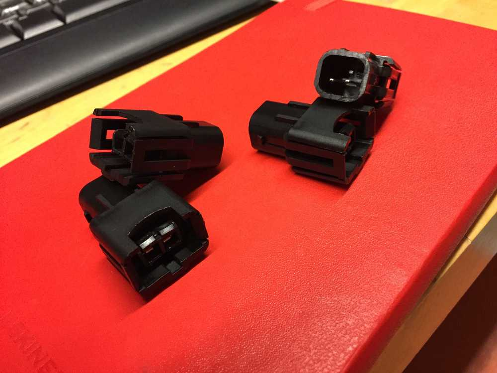 Port injector adapters.
