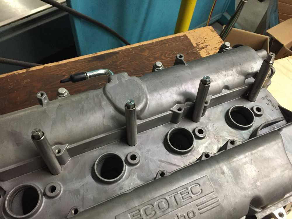 Cylinder head and valve cover top with place holders where the sensors will go.